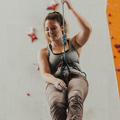 Woman climbing - ladies' night at climbing wall in North Devon
